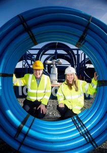 "Kevin Corley Operations Director, Farrans Construction and Sara Venning Chief Executive of NI Water pictured celebrating the ""one million metres"" milestone of watermains on NI Water's ongoing Watermains Improvement Programme."